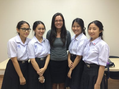 four students with a female Modulo French teacher