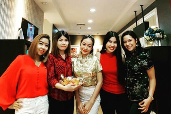 Modulo teachers and employees dressed for Chinese New Year